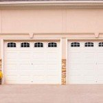 white 2 car traditional garage door